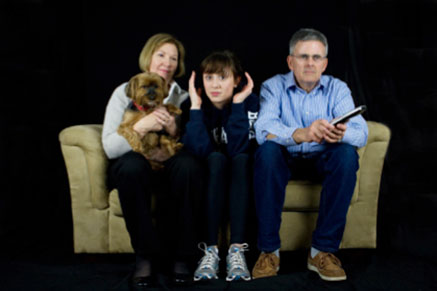 Parents and teen on couch